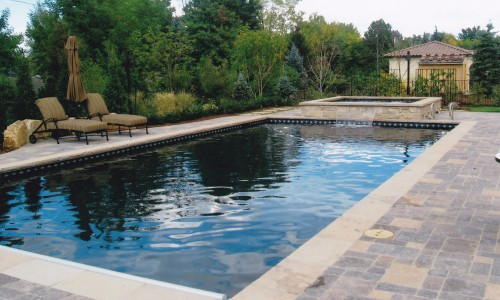 pool and spa with water feature