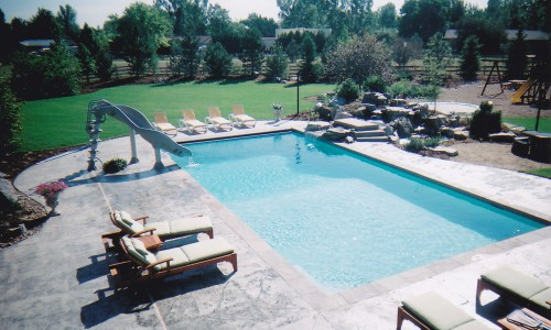 Pool with slide and water feature