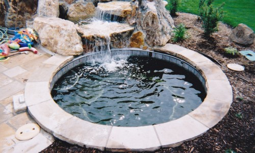 spa with rock water feature